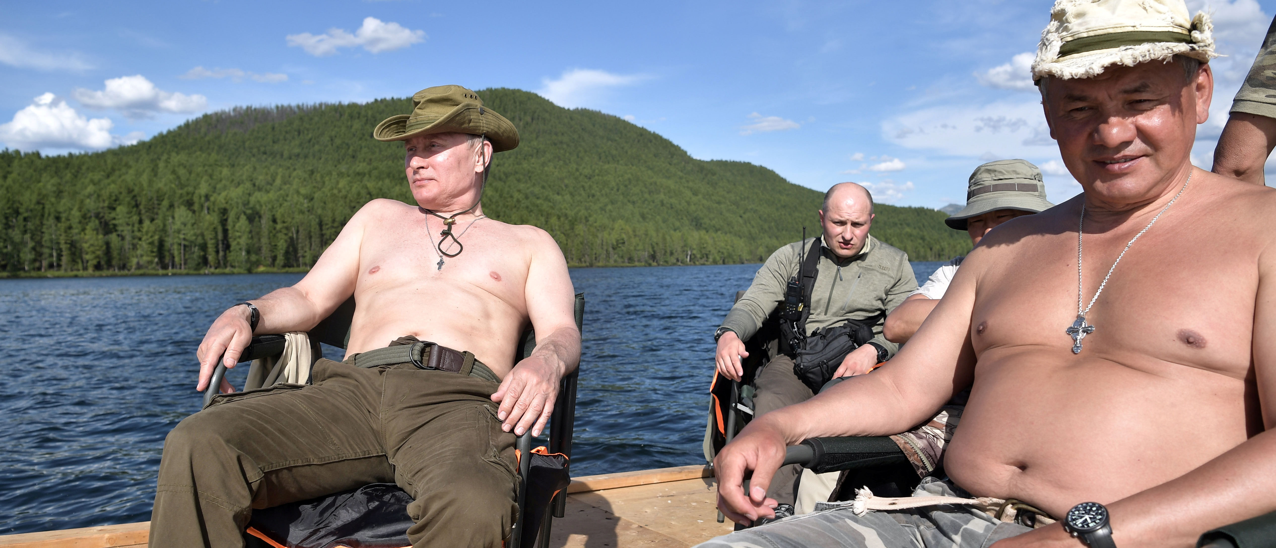 Reuters/ Russian President Vladimir Putin and Defence Minister Sergei Shoigu rest during the hunting and fishing trip which took place on August 1-3 in the republic of Tyva in southern Siberia, Russia, in this photo released by the Kremlin on August 5, 2017. Sputnik/Alexei Nikolsky/Kremlin via REUTERS ATTENTION EDITORS - THIS IMAGE WAS PROVIDED BY A THIRD PARTY. - RTS1AILB