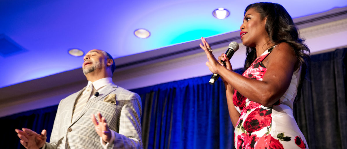 White House aide Omarosa Manigault (L) speaks as panel moderator Edward Gordon reacts during a panel discussion at the National Association of Black Journalists convention in New Orleans, Louisiana, U.S. August 11, 2017.  REUTERS/Omar Negrin