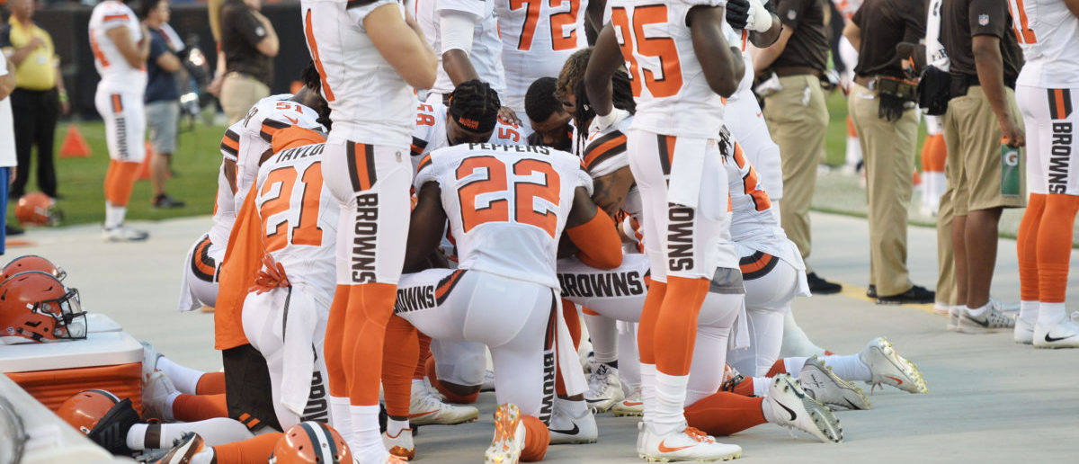 Aug 21, 2017; Cleveland; Members of the Cleveland Browns kneel during the national anthem before a game against the New York Giants at FirstEnergy Stadium. (Ken Blaze-USA TODAY Sports)