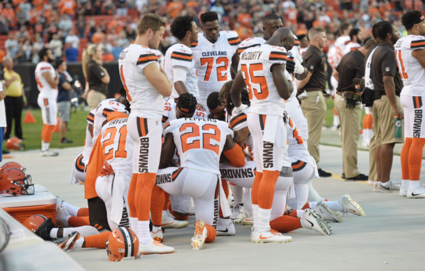 Aug 21, 2017; Cleveland, OH, USA; Members of the Cleveland Browns kneel during the national anthem before a game against the New York Giants at FirstEnergy Stadium. Mandatory Credit: Ken Blaze-USA TODAY Sports/Via Reuters - RTS1CQO6