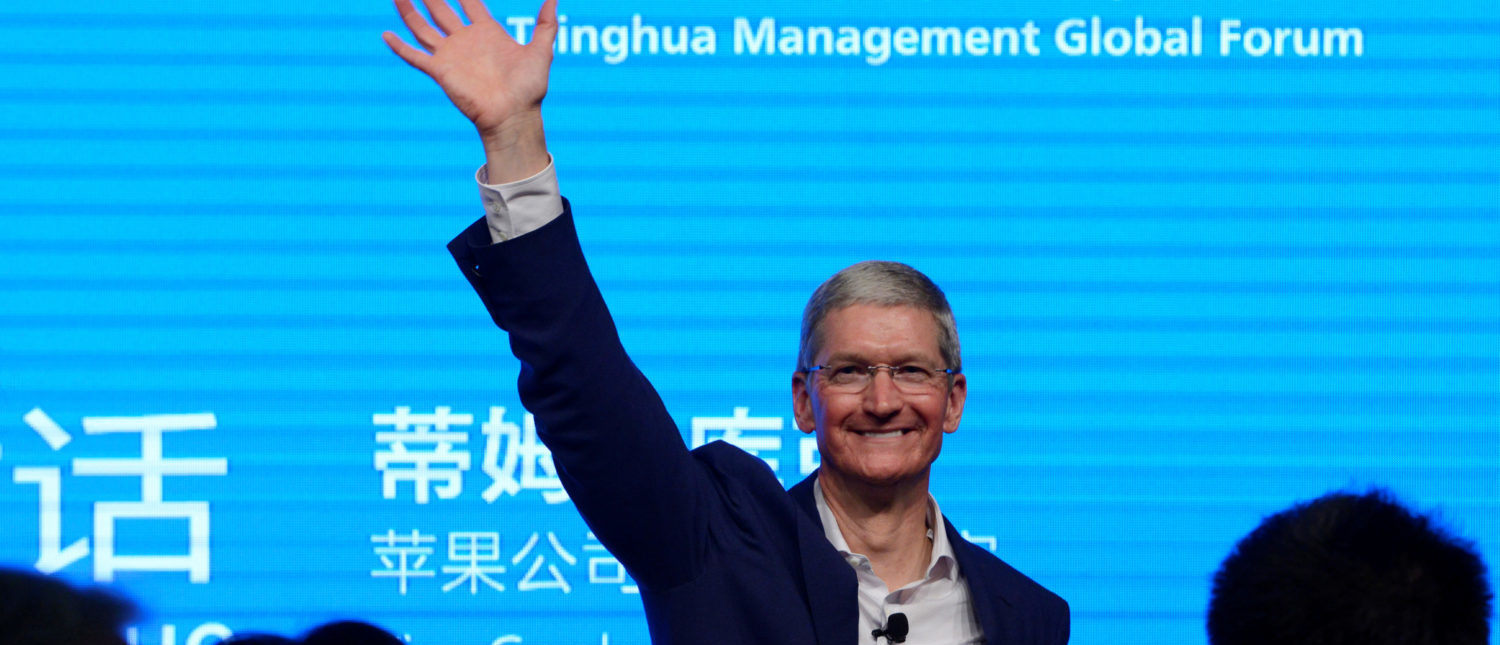Apple CEO Tim Cook waves as he attends a talk in Beijing October 23, 2014. China Daily/via REUTERS