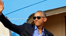 """If you can't beat them, join them. Barack Obama joined the viral """"thanks Obama"""" craze of his critics and filmed himself trying to dunk a cookie too big for his glass of milk while muttering, """"thanks Obama"""" (REUTERS/Kevin Lamarque)"""