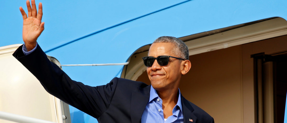 "If you can't beat them, join them. Barack Obama joined the viral ""thanks Obama"" craze of his critics and filmed himself trying to dunk a cookie too big for his glass of milk while muttering, ""thanks Obama"" (REUTERS/Kevin Lamarque)"