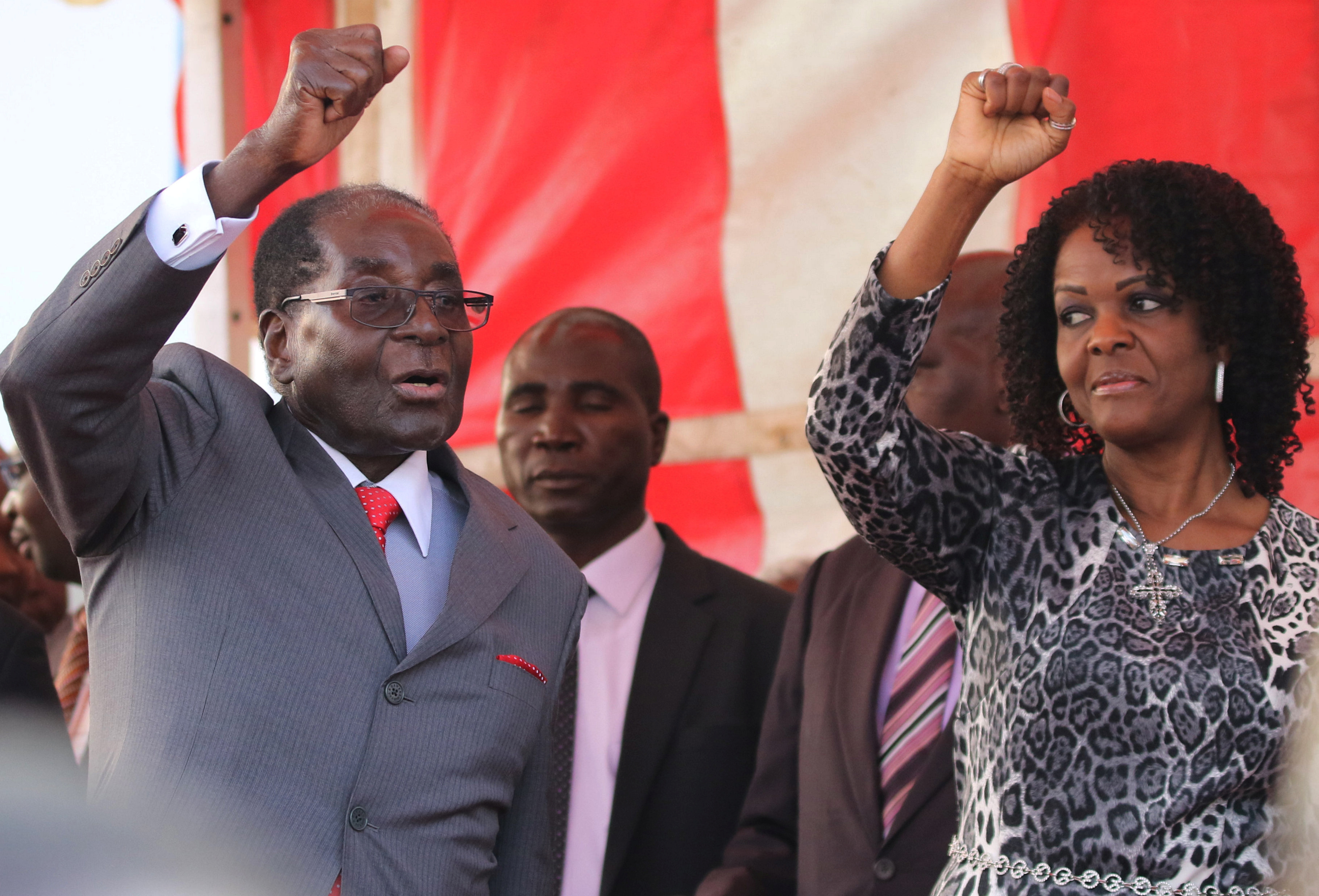 Zimbabwe's first lady has surrendered to police over an alleged hotel assault