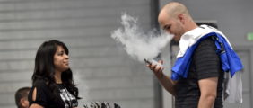 Jerred Marsh (R) samples flavored vape juice from Nancy Reyes at the Vape Summit 3 in Las Vegas, Nevada May 2, 2015. According to new research provided to Reuters, youngsters say that the flavors of the vaping liquids is one of the top two reasons they began using e-cigarette. REUTERS/David Becker