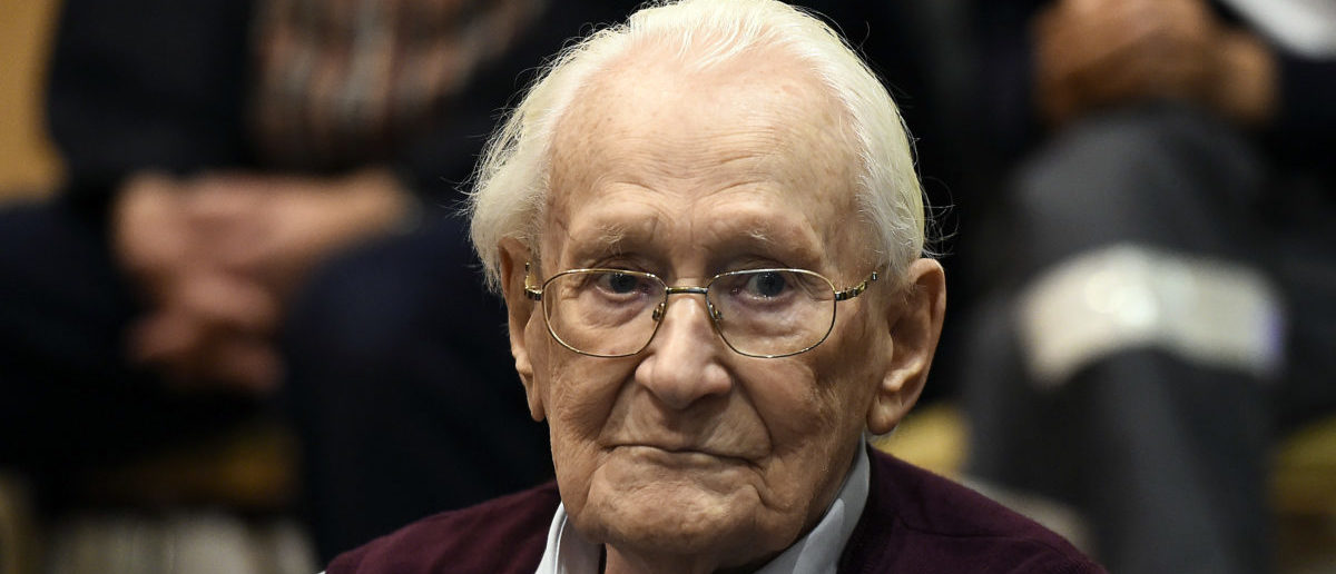 "Oskar Groening, defendant and former Nazi SS officer dubbed the ""bookkeeper of Auschwitz"", sits in the courtroom during his trial in Lueneburg, Germany, July 15, 2015. The 94-year-old German man who worked as a bookkeeper at the Auschwitz death camp was convicted on Wednesday of being an accessory to the murder of 300,000 people and was sentenced to four years in prison, in what could be one of the last big Holocaust trials. REUTERS/Axel Heimken/Pool - RTX1KBTU"