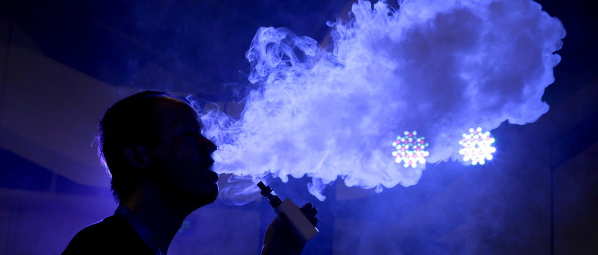 An exhibitor staff member uses an electronic cigarette at Beijing International Vapor Distribution Alliance Expo (VAPE CHINA EXPO) in Beijing, July 24, 2015. According to the organizer, the Expo, which is held in Beijing from July 23 to 25, attracts over 120 companies, including global high-end e-cigarette and e-liquid brands. China's capital city unrolled ambitious new curbs on smoking in early June. Under the new rules, anyone in Beijing who violates the ban, which includes smoking in restaurants, hotels, schools and hospitals as well as in certain outdoor public places, must pay a 200 yuan ($32.25) fine. REUTERS/Jason Lee