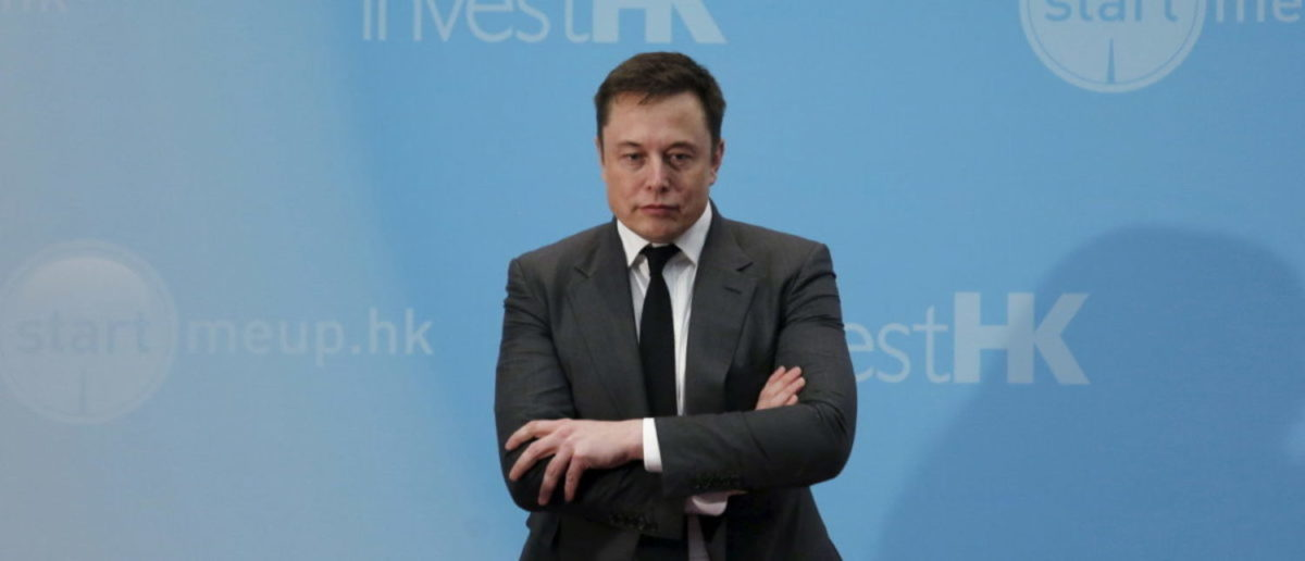Tesla Chief Executive Elon Musk stands on the podium as he attends a forum on startups in Hong Kong, China January 26, 2016. REUTERS/Bobby Yip/File Photo | Musk Goes Full Trump On Big Media