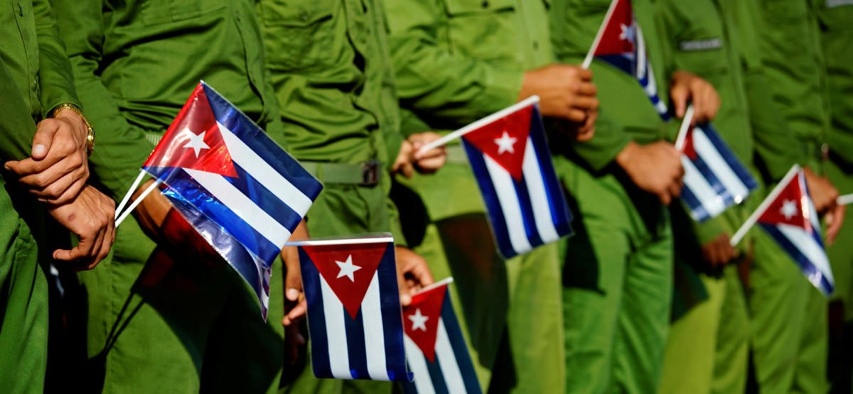 Army soldiers hold Cuban flags as they mark the 60th anniversary of the killing of Cuban revolutionary and student leader Jose Antonio Echeverria in Havana, Cuba, March 13, 2017. REUTERS/Alexandre Meneghini - RTX30UR1