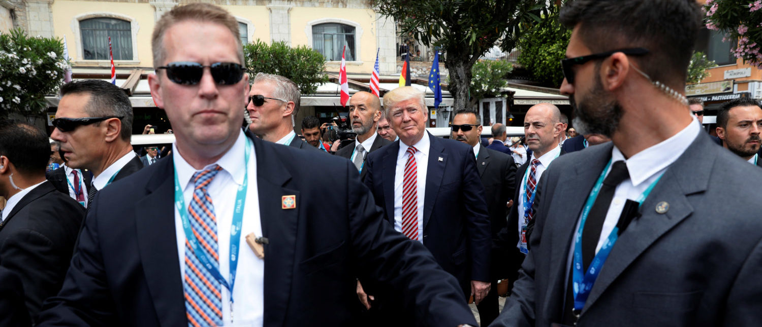 U.S. President Donald Trump is surrounded by Secret Service for an event with fellow G7 leaders during their summit in Taormina, Sicily, Italy, May 26, 2017. (Photo: REUTERS/Jonathan Ernst)