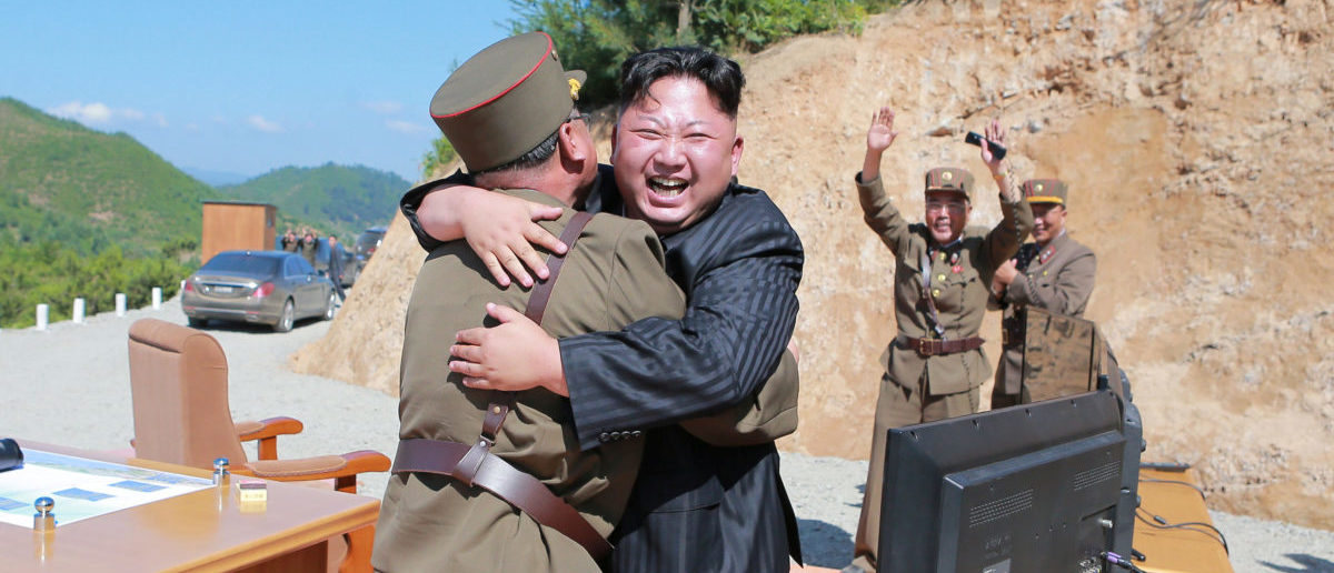 North Korean leader Kim Jong Un reacts with scientists and technicians of the DPRK Academy of Defence Science after the test-launch of the intercontinental ballistic missile Hwasong-14 in this undated photo released by North Korea's Korean Central News Agency (KCNA) in Pyongyang July, 5, 2017. KCNA/via REUTERS