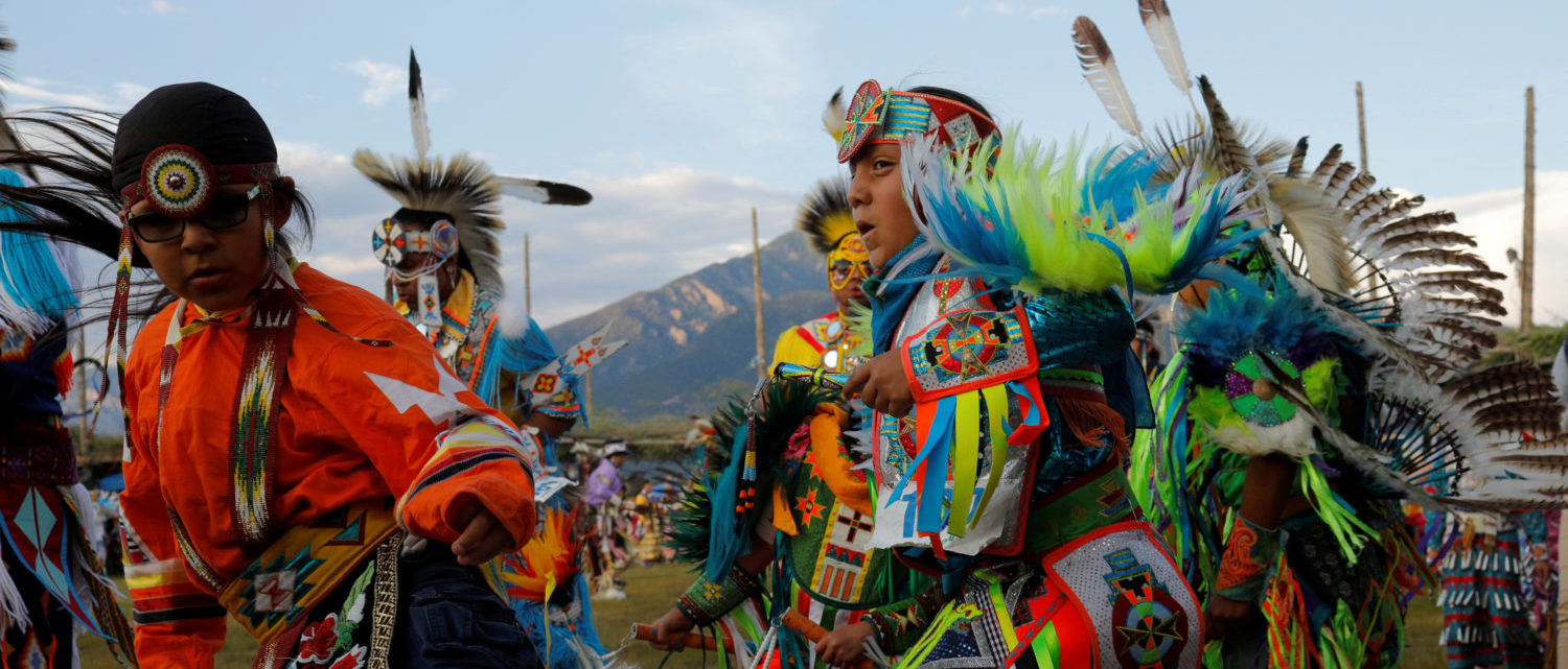 Dancers take part in the evening Grand Entry on the second day of the 32nd Annual Taos Pueblo Pow Wow, a Native American dance competition and social gathering, in Taos, New Mexico, U.S., July 8, 2017.   REUTERS/Brian Snyder - RTX3AOON