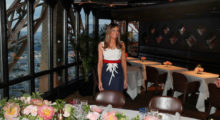 Melania Trump smiles at the Jules Verne restaurant before a private dinner at the Eiffel Tower in Paris, France, July 13, 2107 in a red, white and blue dress. REUTERS/Kevin Lamarque - RTX3BD6B