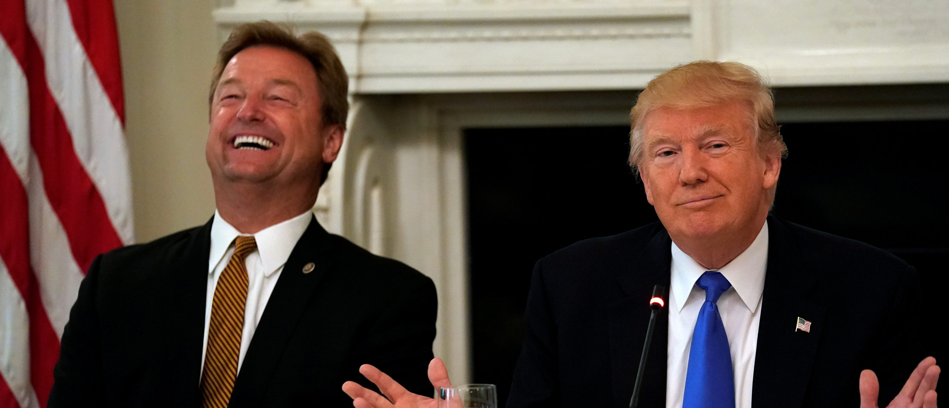Senator Dean Heller (R-NV) reacts as U.S. President Donald Trump speaks during a lunch meeting with Senate Republicans to discuss healthcare at the White House in Washington, U.S., July 19, 2017. REUTERS/Kevin Lamarque - RTX3C478