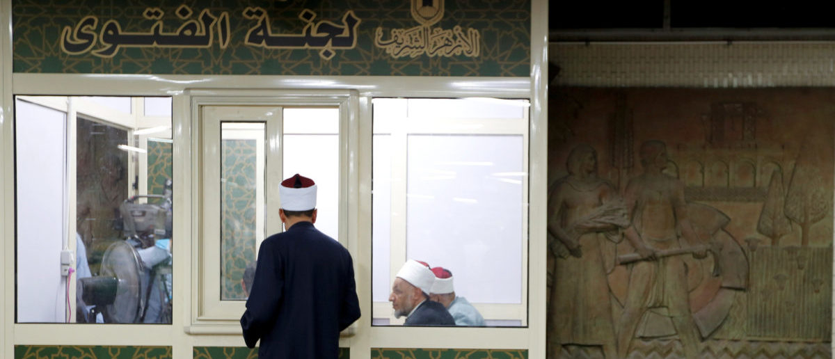 Al-Azhar clerics wait to answer questions at a recently installed Fatwa kiosk offering subway commuters religious guidance and advice at Al Shohadaa metro station in Cairo, Egypt July 24, 2017, as part of an initiative by Al-Azhar, one of the world's oldest religious institutions, aimed at countering extremism. Picture taken July 24, 2017. REUTERS/Amr