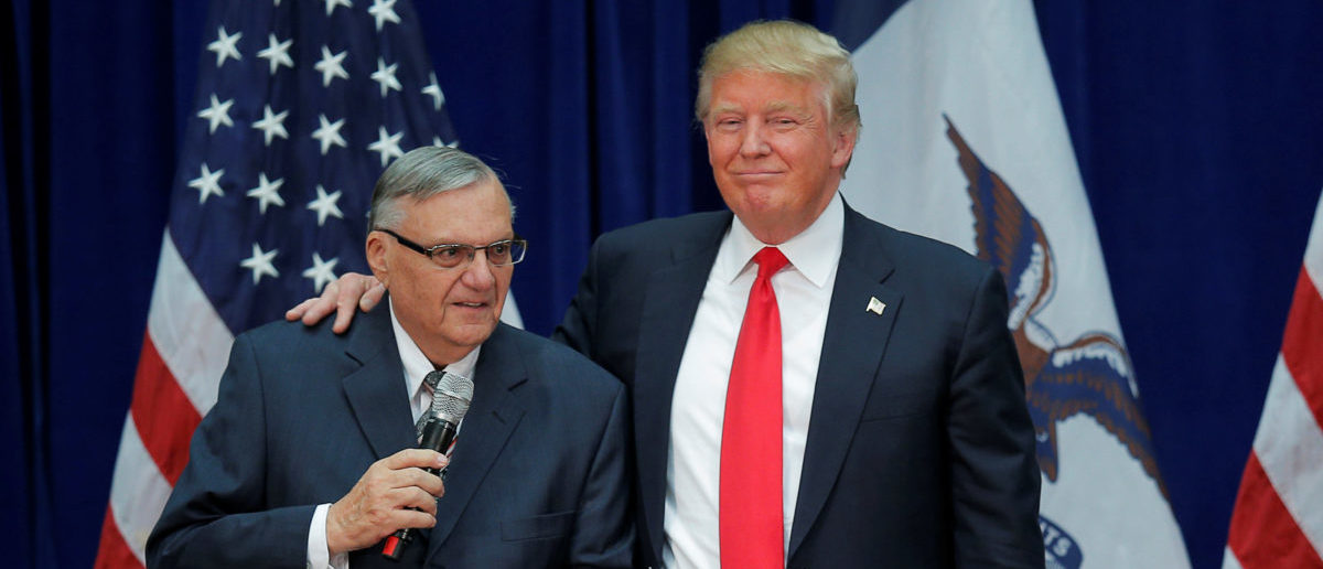 FILE PHOTO: U.S. Republican presidential candidate Donald Trump is joined onstage by Maricopa County Sheriff Joe Arpaio (L) at a campaign rally in Marshalltown, Iowa January 26, 2016, after Arpaio endorsed Trump's candidacy. REUTERS/Brian Snyder/File Photo