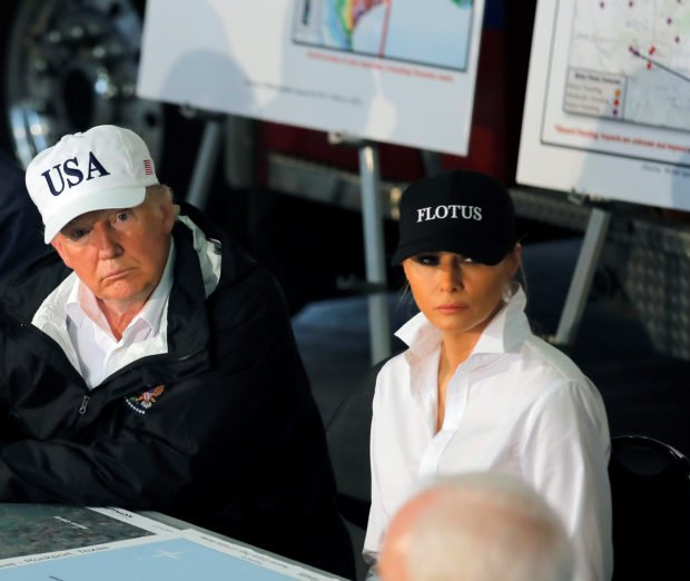 U.S. President Donald Trump and first lady Melania Trump receive a briefing on Tropical Storm Harvey relief efforts with Texas Governor Greg Abbott (L) in Corpus Christi, Texas, U.S., August 29, 2017. REUTERS/Carlos Barria - RTX3DVLB