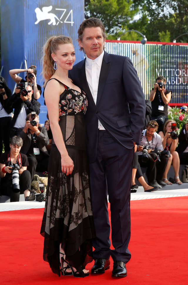 """Actors Ethan Hawke and Amanda Seyfried pose during a red carpet for the movie """"First reformed"""" at the 74th Venice Film Festival in Venice, Italy August 31, 2017. REUTERS/Alessandro Bianchi"""