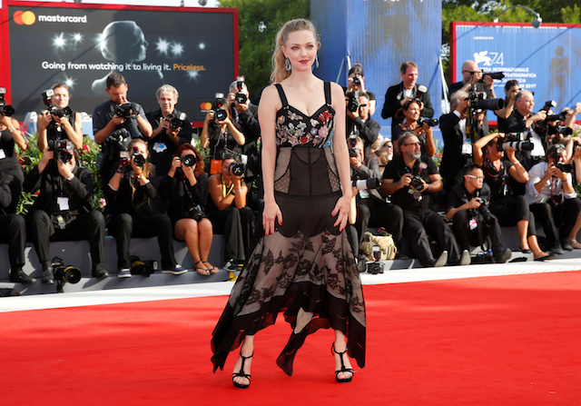 """Actor Amanda SeyaActor Amanda Seyfried poses during a red carpet event for the movie """"First reformed"""" at the 74th Venice Film Festival in Venice, Italy August 31, 2017. REUTERS/Alessandro Bianchifried poses during a red carpet event for the movie """"First reformed"""" at the 74th Venice Film Festival in Venice, Italy August 31, 2017. REUTERS/Alessandro Bianchi - RC161E303500"""