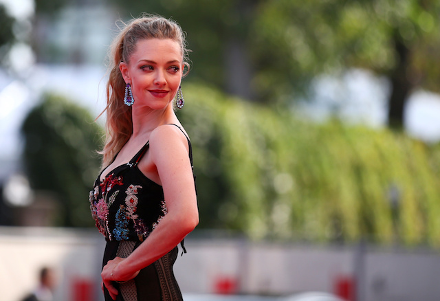 """Actor Amanda Seyfried poses during a red carpet event for the movie """"First reformed"""" at the 74th Venice Film Festival in Venice, Italy August 31, 2017. REUTERS/Alessandro Bianchi"""