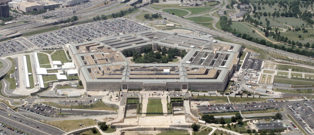 An aerial view of the Pentagon building in Washington, June 15, 2005, with the Potomac river in the foreground. [U.S. Defense Secretary Donald Rumsfeld defended the Guantanamo prison against critics who want it closed by saying U.S. taxpayers have a big financial stake in it and no other facility could replace it at a Pentagon briefing on Tuesday.] - RTXNK9J