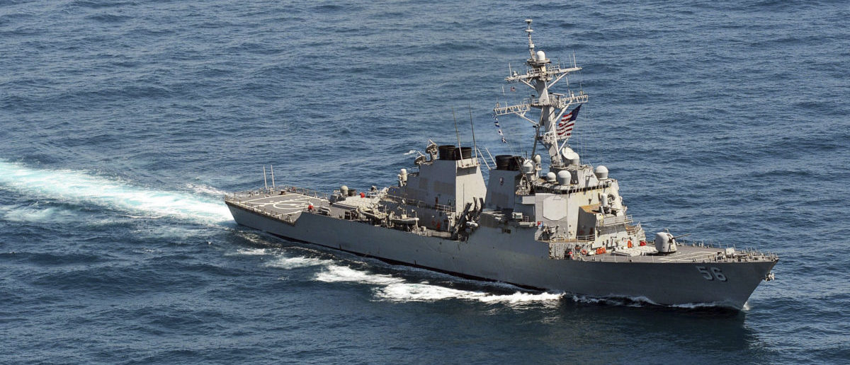 The guided-missile destroyer USS John S. McCain sails in formation during exercise Foal Eagle 2013 in waters west of the Korean peninsula in this March 21, 2013 handout photo courtesy of the U.S. Navy. The Pentagon said on Tuesday that a second U.S. guided-missile destroyer had taken position in the western Pacific on a missile defense mission, as tensions rise over North Korea's threats of war against the United States and its ally, South Korea. REUTERS/U.S. Navy/Mass Communication Specialist 3rd Class Declan Barnes/Handout
