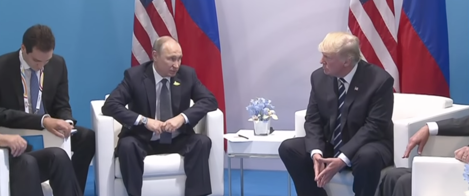 U.S. President Trump and Russian President Putin meet at the G20 in July 2017. (YouTube Screenshot/BBC News)