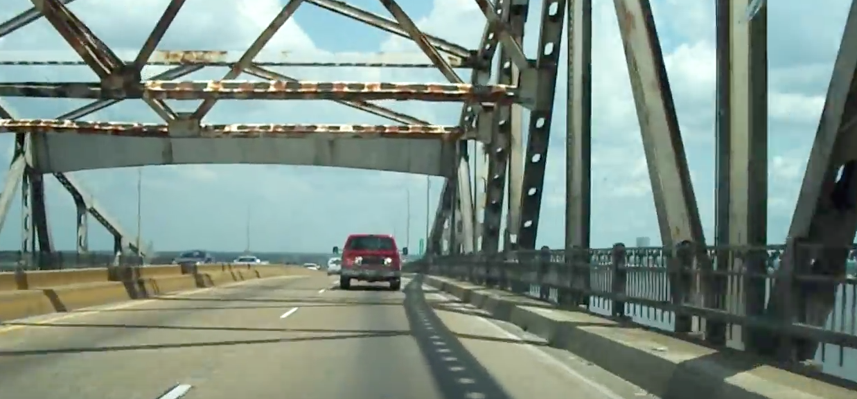 Cars driving over bridge. (youtube screenshot/videopokerplayer85)