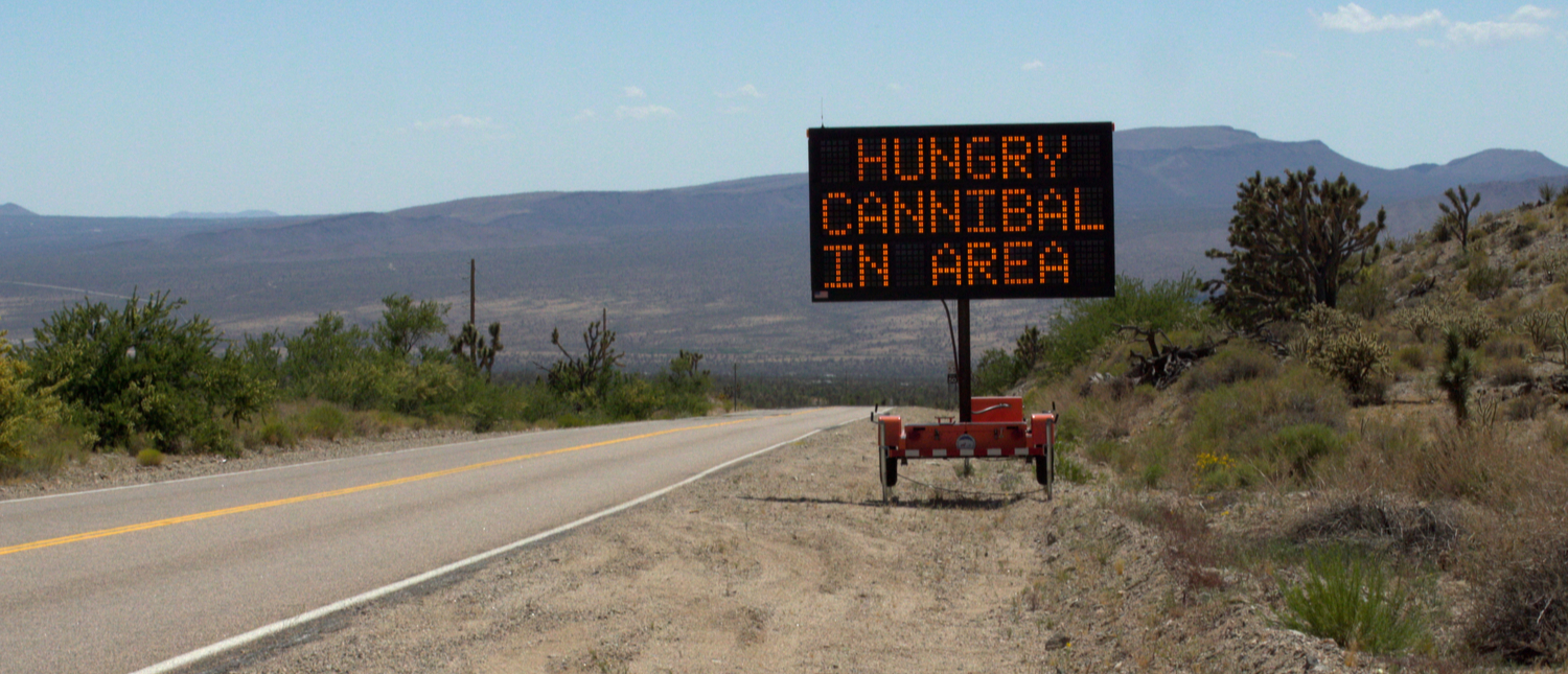 Prank sign warns of a hungry cannibal, which are all too real in South Africa (Photo: Shutterstock/glandryjr)