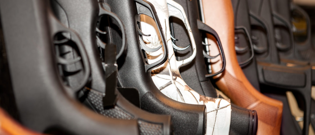 Shutterstock/ Guns arsenal collection, close-up of guns and their grips