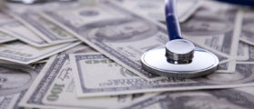 Health care- stethoscope on a pile of money (Photo: Shutterstock/By Helder Almeida)