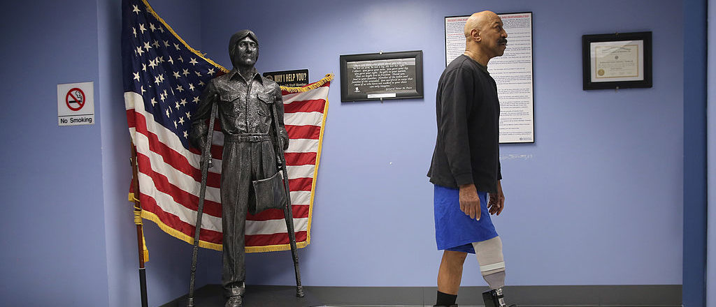 Military veteran and amputee Lloyd Epps walks after doctors serviced his prosthetic leg at the Veterans Administration (VA), hospital on January 29, 2014 in Manhattan, New York City. Epps, who lost his leg to an infection in 2010, wears a hightech custom prosthetic from the VA which powers his gait forward.  (Photo by John Moore/Getty Images)