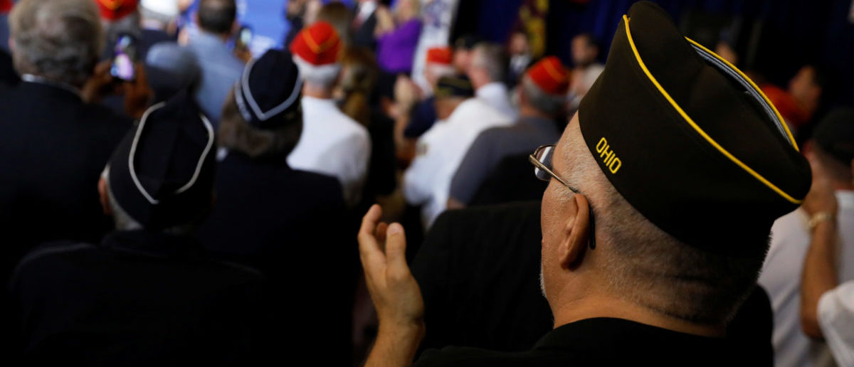 A supporter claps as President Donald Trump participates in an event celebrating veterans at AMVETS Post 44 in Struthers, Ohio, July 25, 2017. REUTERS/Jonathan Ernst