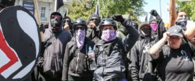 Antifa members and counter protesters gather during a rightwing No-To-Marxism rally on August 27, 2017 at Martin Luther King Jr. Park in Berkeley, California. Amy Osborne/AFP/Getty Images.