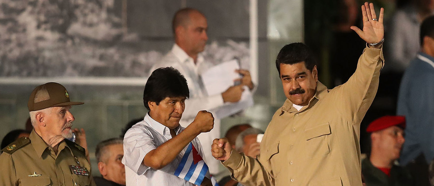 DECEMBER 03: President of Bolivia Evo Morales (L) greets Venezuela's President Nicolas Maduro at a memorial tribute for former President of Cuba Fidel Castro at the Antonio Maceo Revoloution Square before his burial tomorow on December 3, 2016 in Santiago de Cuba, Cuba. Mr. Castro died on November 25th at the age of 90 and the country is in the midst of a 9 day mourning period that lasts until his funeral on Sunday in Santiago de Cuba at the CementerioÊSanta Ifigenia. (Photo by Joe Raedle/Getty Images)
