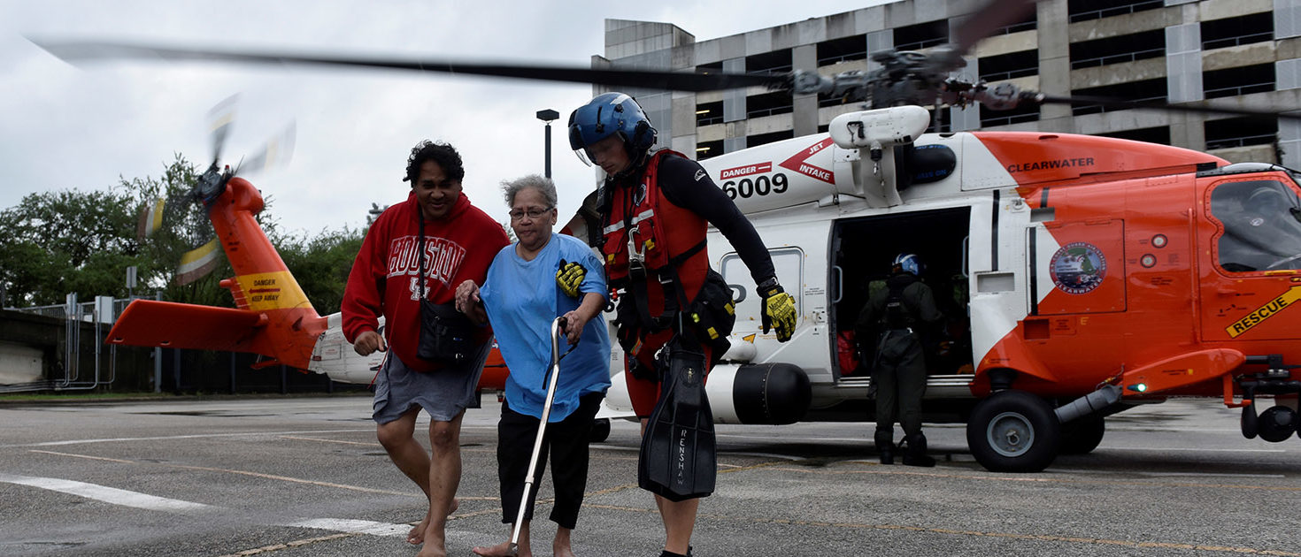 Evacuees Rickey Manuel (L) and Marjory Manuel (C) exit a U.S. Coast Guard helicopter that rescued them after Hurricane Harvey inundated the Texas Gulf coast with rain and flooded their home, in Houston, Texas, U.S. August 27, 2017. REUTERS/Nick Oxford