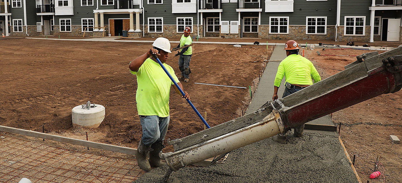 Workers finish a sidewalk at Canal Crossing, a new luxury apartment community consisting of 393 rental units near the university city of New Haven on August 2, 2017 in Hamden, Connecticut. According to a Pew Research Center analysis of Census Bureau housing data, more U.S. households are headed by renters than at any point since at least 1965. Sixty-five percent of households headed by people under the age of 35 were renting in 2016, an increase from the 2006 figure of 57 percent. (Photo by Spencer Platt/Getty Images)