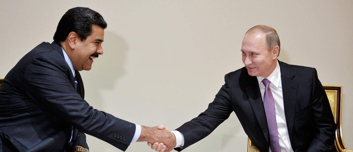 Russian President Vladimir Putin (R) shakes hands with his Venezuelan counterpart Nicolas Maduro during a meeting on the sidelines of the Gas Exporting Countries Forum (GECF) summit in Tehran on November 23, 2015. PHOTO: Getty Images/AFP/ALEXEI DRUZHININ