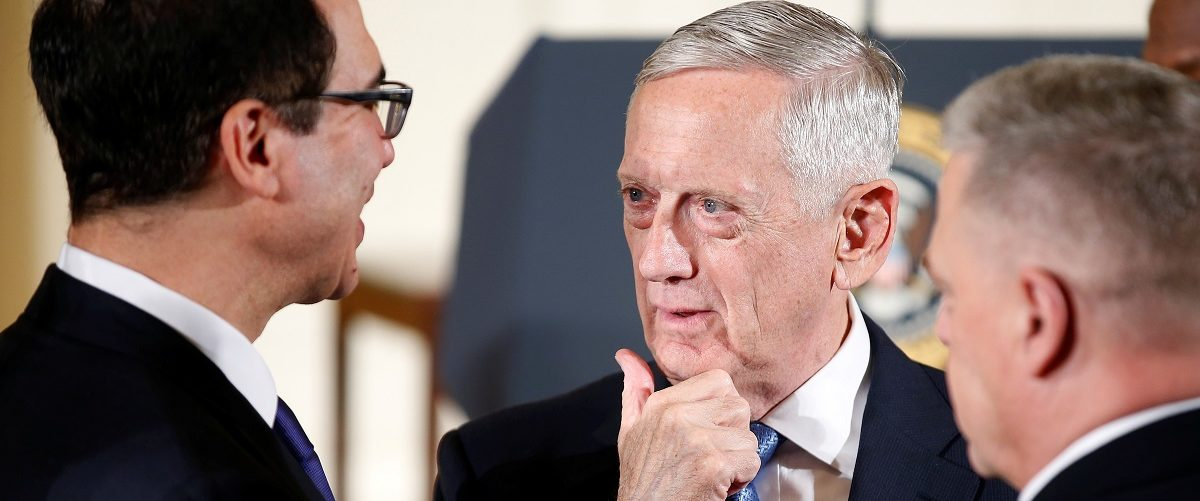 U.S. Secretary of Defense Mattis speaks with U.S. Secretary of the Treasury Mnuchin at the White House in Washington