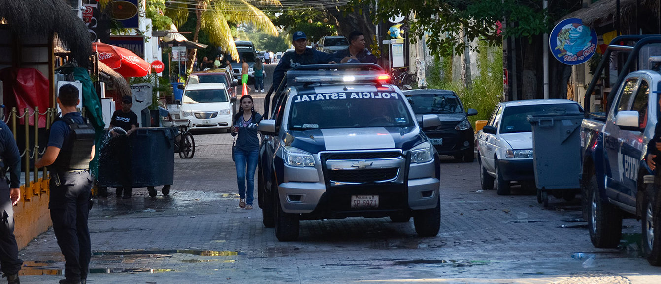 Mexican police agents patrol near a nightclub in Playa del Carmen, Quintana Roo state, Mexico where 5 people were killed, three of them foreigners, during a music festival on January 16, 2017. A shooting erupted at an electronic music festival in the Mexican resort of Playa del Carmen early Monday, leaving at least five people dead and sparking a stampede, the mayor said. Fifteen people were injured, some in the stampede, after at least one shooter opened fire before dawn at the Blue Parrot nightclub during the BPM festival. (PHOTO: STR/AFP/Getty Images)