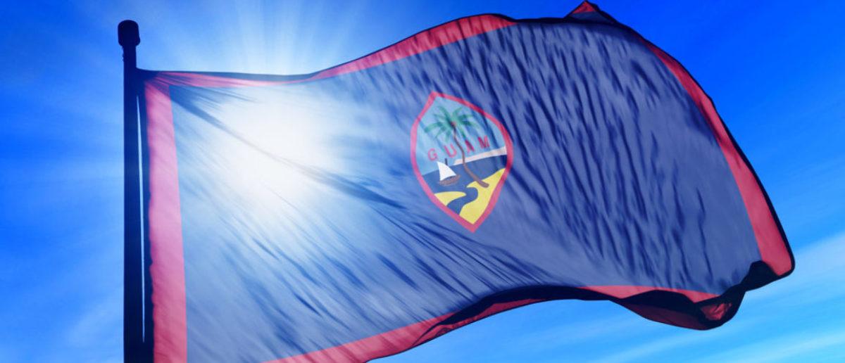 Guam flag waving on the wind (Jiri Flogel/shutterstock_155594351)