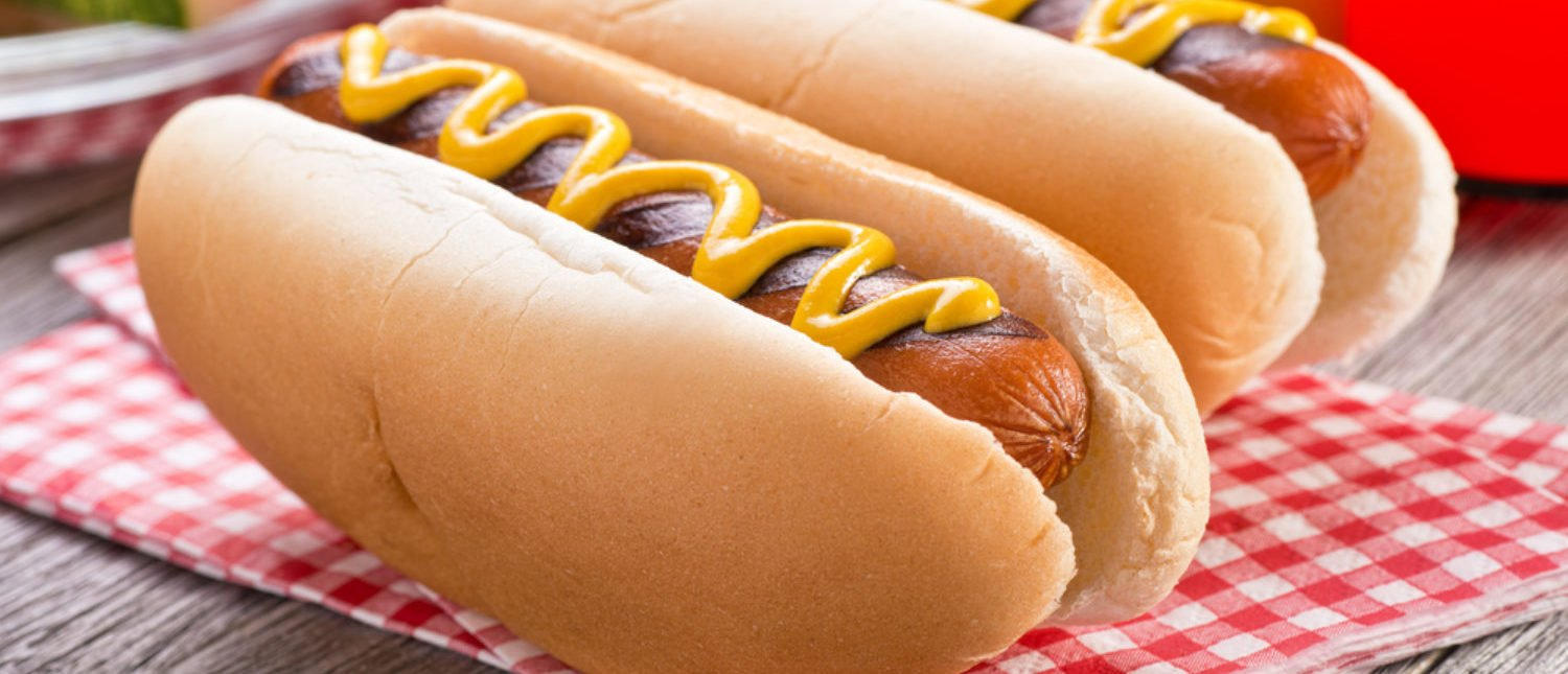 Hot dogs with mustard. [Shutterstock - Foodio]