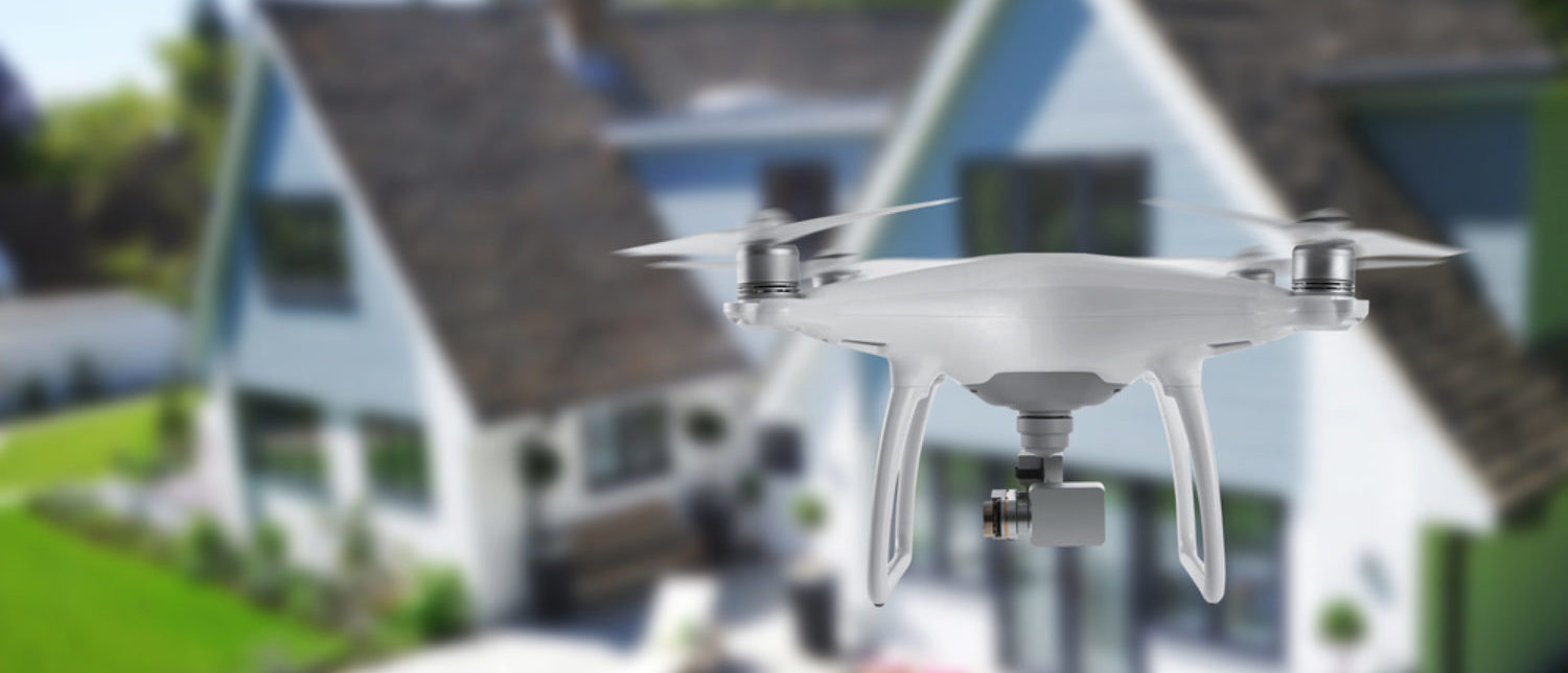 Drone equipped with camera spying on people in their home. [Shutterstock - Stanisic Vladimir]