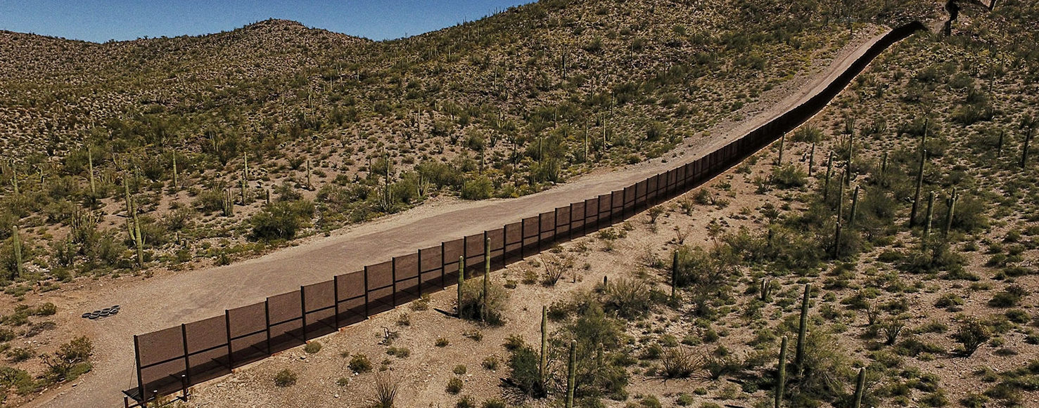 View of the metal fence along the border in Sonoyta, Sonora state, northern Mexico, between the Altar desert in Mexico and the Arizona desert in the United States, on March 27, 2017. (PHOTO: Getty Images/AFP/PEDRO PARDO)