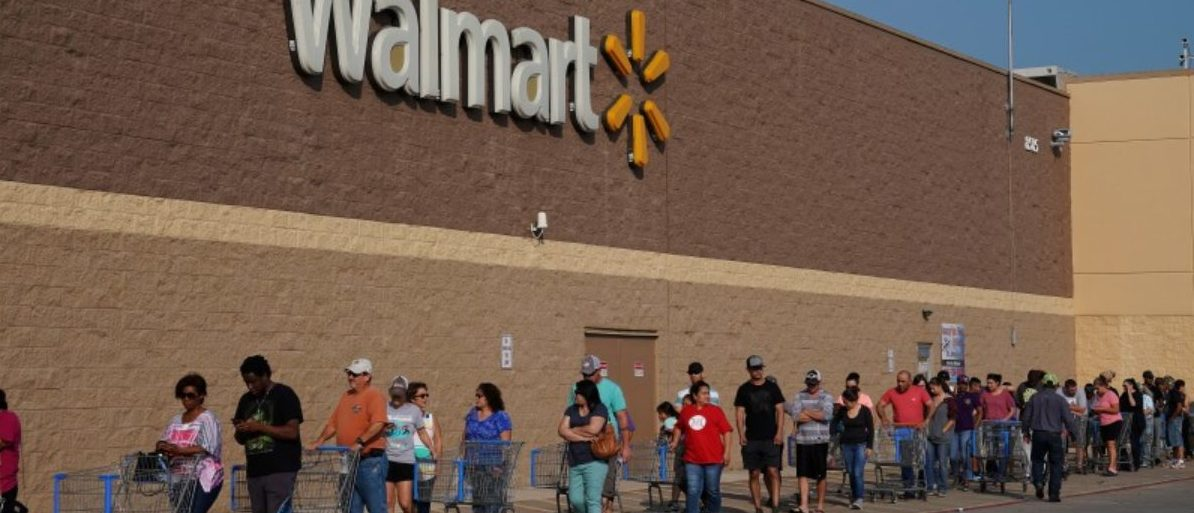 People line up at a Walmart store that reopened after Tropical Storm Harvey in Port Arthur, Texas