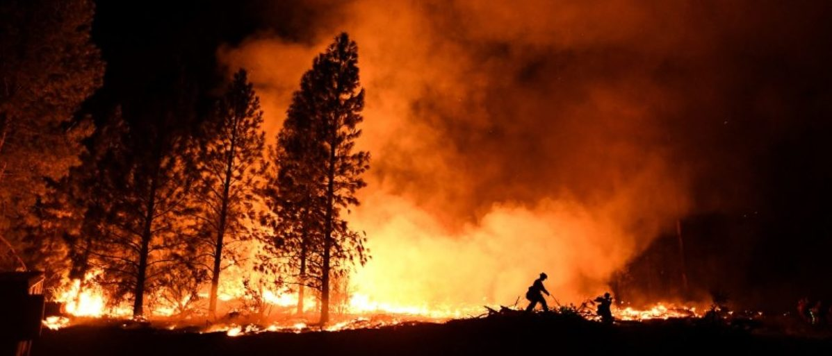 A firefighter battles the Ponderosa Fire east of Oroville