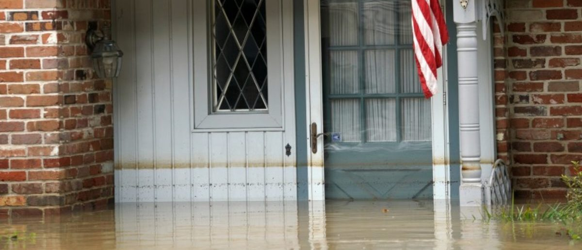 The high water mark is visible on a house in Houston. REUTERS/Rick Wilking