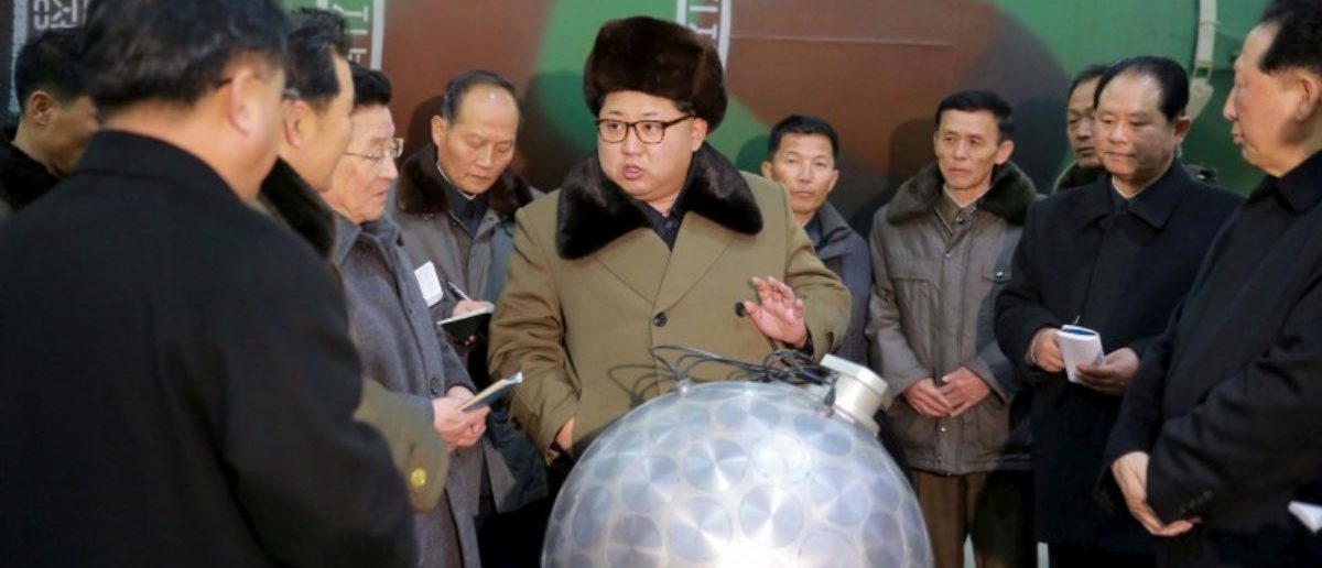 North Korean leader Kim Jong Un meets scientists and technicians in the field of researches into nuclear weapons in this undated photo released by North Korea's Korean Central News Agency (KCNA) in Pyongyang March 9, 2016. REUTERS/KCNA/File Photo