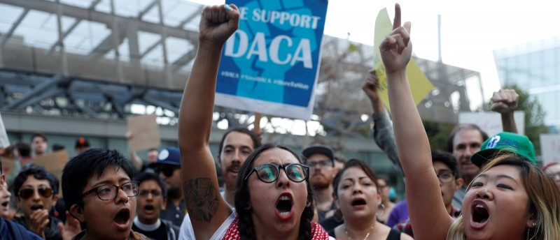 Demonstrators chant during a rally against the rescindment of DACA (Deferred Action for Childhood Arrivals) program outside the San Francisco Federal Building in San Francisco, California, U.S., September 5, 2017. REUTERS/Stephen Lam