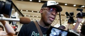 FILE PHOTO: Former NBA basketball player Dennis Rodman is surrounded by the media after arriving from North Korea's Pyongyang at Beijing airport, China June 17, 2017. REUTERS/Thomas Peter/File Photo